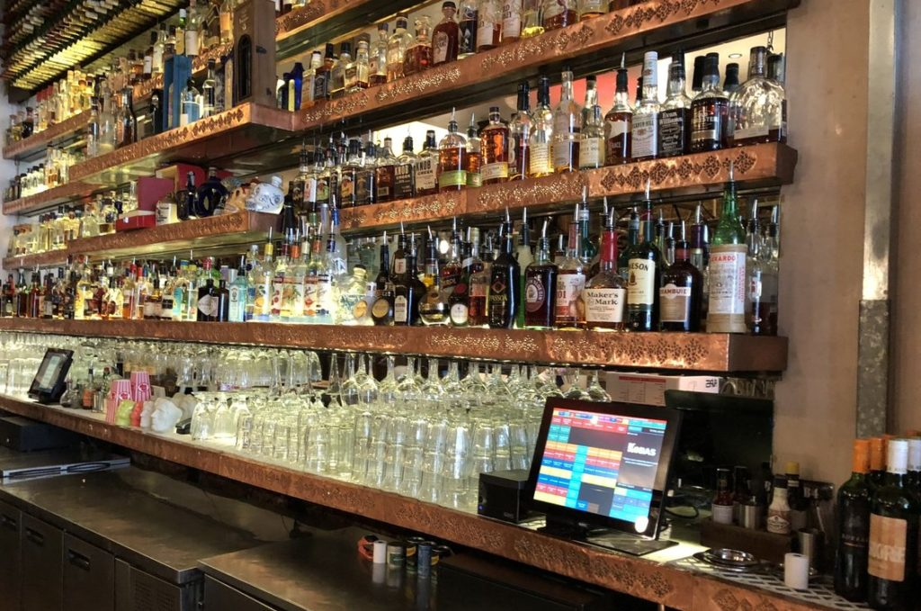 Wide angle shot of a very well stocked bar and two Kobas tills